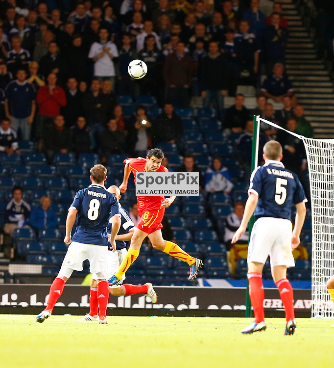 Scotland v Macedonia FIFA World Cup Qualifier.Vanche Shikov heads the ball towards goal watched by Andrew Webster and Gary Cadwell..(c) STEPHEN LAWSON | StockPix.eu