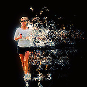 Woman runs in a park Digitally manipulated with blazing trail