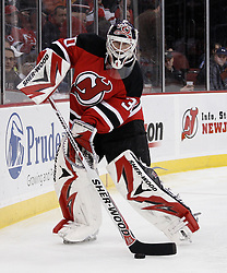 Dec 30, 2009; Newark, NJ, USA; New Jersey Devils goalie Martin Brodeur (30) plays the puck during the first period of their game against the Penguins at the Prudential Center.