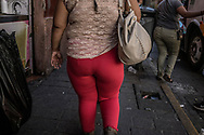 Overweight women navigating the side-streets of Guadalajara.  Mexico.  The OECD ranked Mexico as having the second highest adult obesity rate in the world at 32.4%, only behind the United States.  In 2016, according to Mexico's health ministry, 72.5% of adults were overweight or obese.  After implementation of NAFTA in 1994, Mexico became a dumping ground for US sugary drinks, fast food, and US subsidized corn and soy crops - leading to a corresponding increase in diabetes.  Mexico also suffers from child malnutrition rates that exceed 365 in 7 Mexican states (World Vision Mexico, 2015).  Malnutrition is more intense in indigenous communities.
