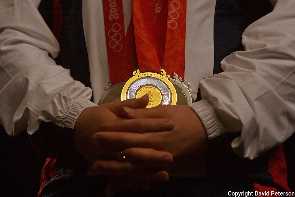 """Olympian Shawn Johnson shows off her four Olympic medals, including a gold for the balance beam, at a homecoming on August 26 in Des Moines, Iowa. The event was attended by over 7,000 fans who filled the Wells Fargo Arena in Des Moines.   The city of Des Moines declared the month of September """"Shawn Johnson Month"""".  As one of the most recognizable faces of the Beijing Olympics, Johnson has been on a whirlwind post Olympics tour, which has included an appearance on The David Letterman Show.  She will also appear on Jay Leno, and will lead the Pledge of Allegiance at this year's Democratic Convention."""