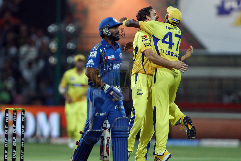 Dwayne Bravo congratulates Albie Morkel on taking the wicket of Dinesh Karthik during the IPL 2012 Season 5 eliminator match between The Mumbai Indians and The Chennai Superkings held at the M. Chinnaswamy Stadium, Bengaluru on the 23rd May 2012..Photo by Jacques Rossouw/IPL/SPORTZPICS