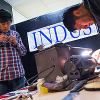 121413       Cable Hoover<br /> <br /> Silversmiths Alonzo John, left, and Jude Candelaria put on a demonstration at Industry Gallery during Arts Crawl Saturday in downtown Gallup.