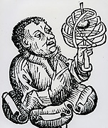 Medieval astronomer with an armillary sphere. Woodcut, 1493.