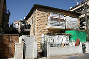 Israel, Jerusalem A building with a Sukkah in the yard and on the balconies