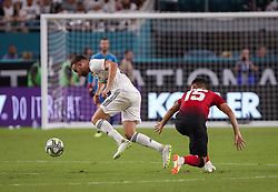July 31, 2018 - Miami Gardens, Florida, USA - Real Madrid C.F. forward Borja Mayoral (21) (left) takes the ball away from Manchester United F.C. midfielder Andreas Pereira (15) (right) during an International Champions Cup match between Real Madrid C.F. and Manchester United F.C. at the Hard Rock Stadium in Miami Gardens, Florida. Manchester United F.C. won the game 2-1. (Credit Image: © Mario Houben via ZUMA Wire)