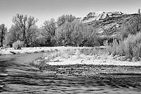 Black and White version. Mt. Timpanogos sits in the backdrop of the Provo River as the early morning light hits its peaks.