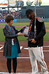 SAN FRANCISCO, CA - APRIL 14:  Madison Bumgarner #40 of the San Francisco Giants is presented with the 2014 Associated Press Athlete of the Year award by writer Janie McCauley before the game against the Colorado Rockies at AT&T Park on April 14, 2015 in San Francisco, California.  The Colorado Rockies defeated the San Francisco Giants 4-1. (Photo by Jason O. Watson/Getty Images) *** Local Caption *** Madison Bumgarner; Janie McCauley
