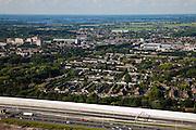 Nederland, Utrecht, Maarssen, 12-06-2009; Autosnelweg A2 ter hoogte van Maarssen, woonwijk ligt verscholen achter het nieuwe monumentale geluidsscherm, de weg wordt verbreed naar 2x5 rijstroken. A2 motorway at Maarssen, the residential area lies hidden behind the monumental new sound barrier, the road is widened to 2x5 lanes; .luchtfoto (toeslag), aerial photo (additional fee required).foto/photo Siebe Swart