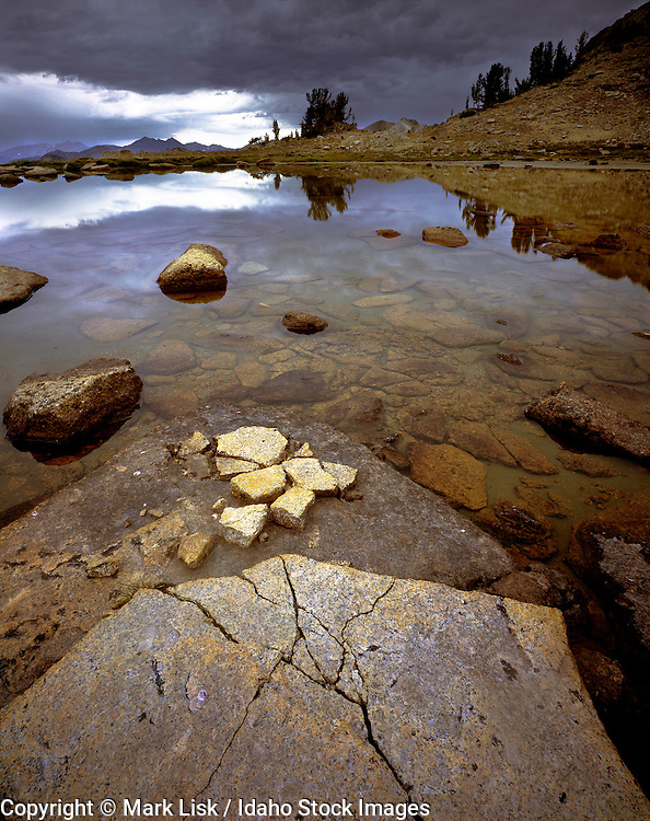 A high altitude catch basin sits at over 10,000 feet high above Chamberlin Basin in the White Cloud Mountains of Central Idaho.