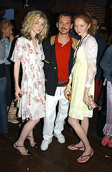 Left to right, model PORTIA FREEMAN, MATTHEW WILLIAMSON and Model LILY COLE at a party to celebrate the launch of the new Matthew Williamson fragrance held at Harvey Nichols, Knightsbridge, London on 14th June 2005.<br />