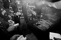 Torretta, Italy, 17 October 2012: Inhabitants of Torretta, a small village in the province of Palermo, grill sausage during a rally for Nino Dina (UdC, Unione di Centro), a representative of the Sicilian Regional Assembly running for the fourth time since 2001 in the 2012 regional elections. Nino Dina was under investigation for Mafia ties in 2008. The case was archived in 2010.<br /> <br /> The direct elections in Sicily for the President of the Region and its representatives will take place on Sunday 28 October 2012, 6 months ahead of the end of the terms of office of the current legislature. The anticipated election of October 28 take place after Raffaele Lombardo, former governor of Sicily since 2008, resigned on July 31st. Raffaele Lombardo is under investigation since 2010 for Mafia ties. His son Toti Lombardo is currently running for a seat in the Sicilian Regional Assembly in the coalition of Gianfranco Micciché, a candidate for the Presidency of the Region. 32 candidates belonging to 8 of the 20 parties running for the Sicilian elections are either under investigation or condemned. ### Torretta, Italia, 17 ottobre 2012: abitanti di Torretta preparano della salsiccia grigliata durante un comizio di Nino Dina (UdC, Unione di Centro), un deputato di 55 anni dell'ARS (Assemblea Regionale Siciliana) che si ricandida per la quarta volta dal 2001. Nino Dina è stato indagato per concorso esterno in associazione mafiosa nel 2008. Il suo fascicolo è stato archiviato nel 2010.<br /> <br /> Le elezioni in Sicilia per la votazione diretta del presidente della regionee dei deputati all'Assemblea regionale (ARS)si terranno domenica 28 ottobre, in anticipo sulla scadenza naturale dell'attuale legislatura, prevista ad aprile dell'anno prossimo. In Sicilia si vota in anticipo dopo le dimissionidel 31 luglio scorso di Raffaele Lombardo, eletto presidente della regione nell'aprile del 2008 e indagato dal 2010 per concorso esterno in associazione mafiosa. 32 candidati appartene