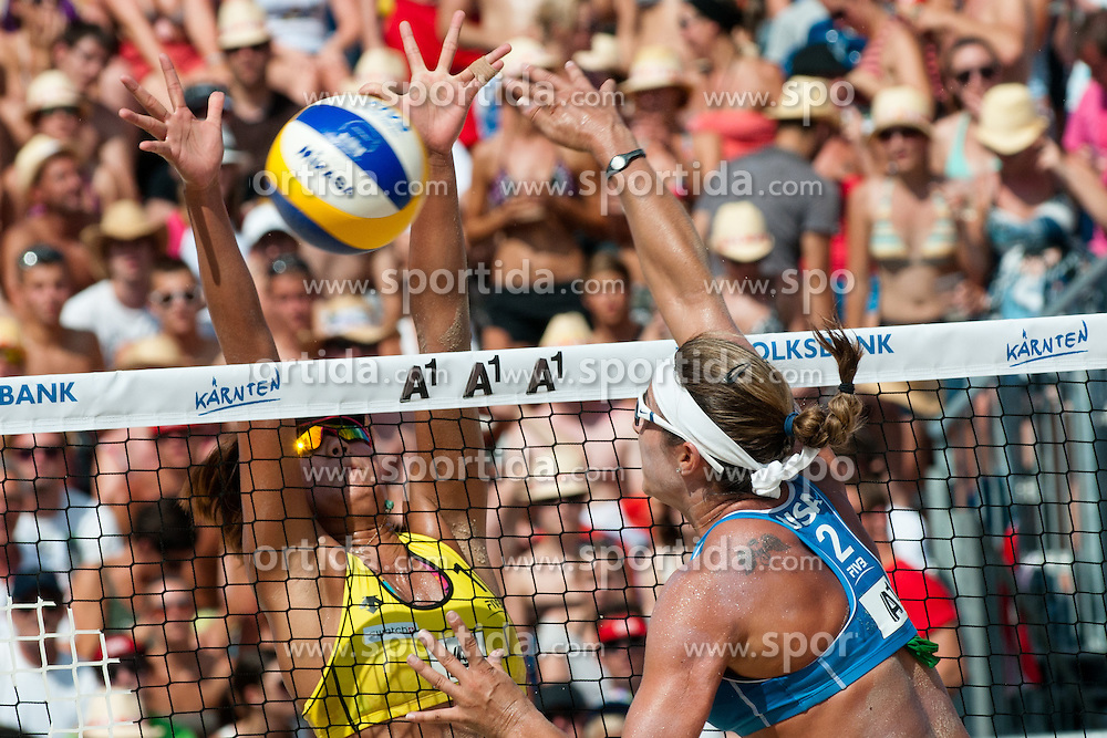 Misty May-Treanor of USA strikes a ball pass the Chen Xue of China block at A1 Beach Volleyball Grand Slam tournament of Swatch FIVB World Tour 2011, on August 6, 2011 in Klagenfurt, Austria. (Photo by Matic Klansek Velej / Sportida)