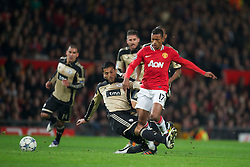 22.11.2011, Old Trafford, Manchester, ENG, UEFA CL, Gruppe C, Manchester United (ENG) vs Benfica Lissabon (POR), im Bild Manchester United's Nani in action against SL Benfica's Ezequiel Garay during the football match of UEFA Champions league, group C, between Manchester United (ENG) vs Benfica Lissabon (POR) at Old trafford, Manchester, United Kingdom on 22/11/2011. EXPA Pictures © 2011, PhotoCredit: EXPA/ Sportida/ David Rawcliff..***** ATTENTION - OUT OF ENG, GBR, UK *****