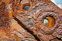 Long Island, New York, Shinnecock Harbor. Rusted piece of metal showing the lovely, warm colors of the rust and metal.