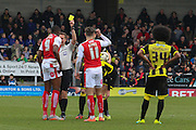 Fleetwood Town forward Shola Ameobi is shown a yellow card for a challenge on Burton Albion midfielder Tom Naylor during the Sky Bet League 1 match between Burton Albion and Fleetwood Town at the Pirelli Stadium, Burton upon Trent, England on 12 March 2016. Photo by Aaron  Lupton.