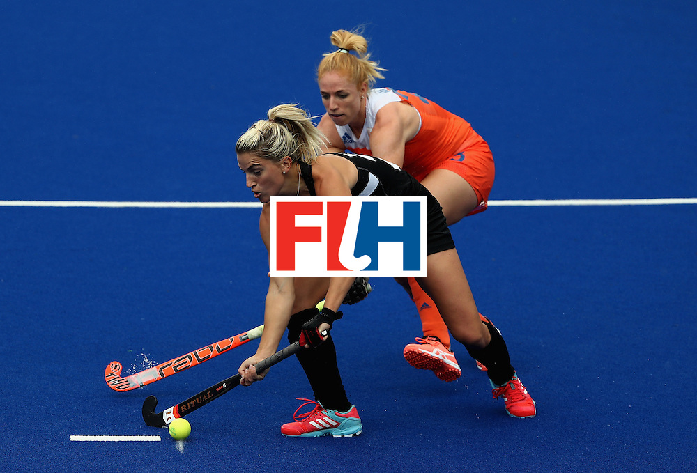 RIO DE JANEIRO, BRAZIL - AUGUST 12:  Margot van Geffen #23 of Netherlands defends Gemma Flynn #22 of New Zealand during a Women's Preliminary Pool A match on Day 7 of the Rio 2016 Olympic Games at the Olympic Hockey Centre on August 12, 2016 in Rio de Janeiro, Brazil.  (Photo by Sean Haffey/Getty Images)