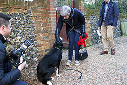 © Licensed to London News Pictures. 07/01/2018. Sonning, UK. British prime minister THERESA MAY meets a dog called Blitz as she leaves a morning church service with her husband PHILIP MAY, near her constituency home. Photo credit: Jon Almasi/LNP