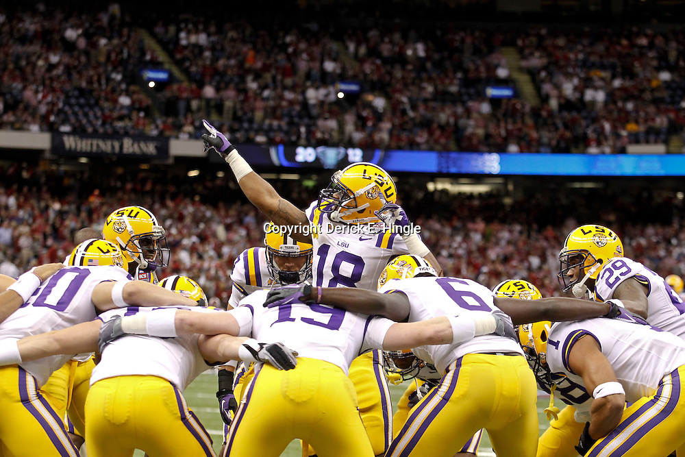 Jan 9, 2012; New Orleans, LA, USA; LSU Tigers safety Brandon Taylor (18) huddles with teammates before the 2012 BCS National Championship game against the Alabama Crimson Tide at the Mercedes-Benz Superdome.  Mandatory Credit: Derick E. Hingle-US PRESSWIRE