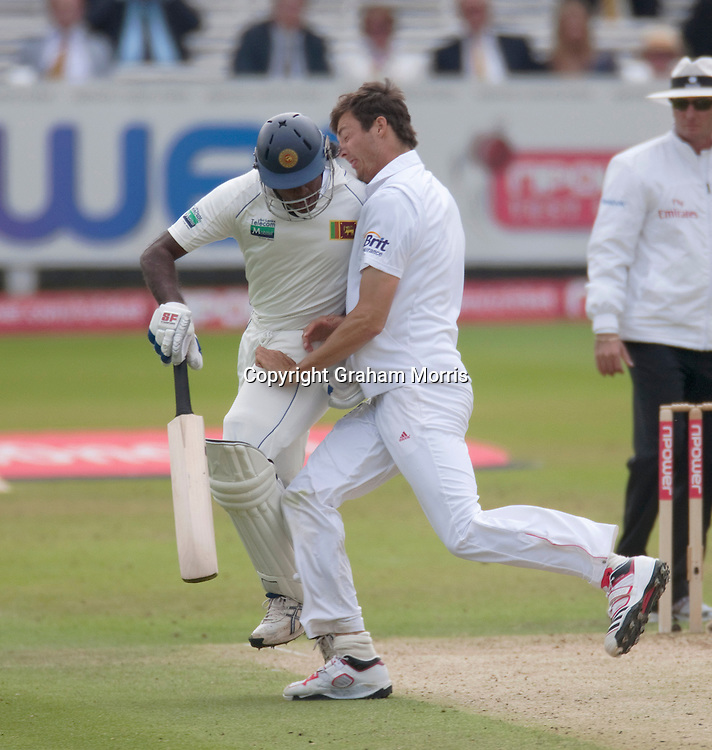 Bowler Steven Finn (right) collides with batsman Dilhara Fernando during the second npower Test Match between England and Sri Lanka at Lord's.  Photo: Graham Morris (Tel: +44(0)20 8969 4192 Email: sales@cricketpix.com) 06/06/11