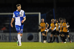 Bristol Rovers' Andy Monkhouse cuts a dejected figure as Gateshead's Matty Pattison celebrates with his team mates after scoring in the background  - Photo mandatory by-line: Dougie Allward/JMP - Mobile: 07966 386802 - 19/12/2014 - SPORT - football - Bristol - Memorial Stadium - Bristol Rovers v Gateshead  - Vanarama Conference