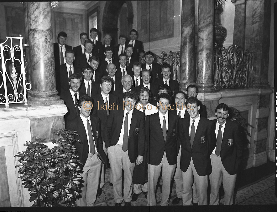 Mayo Football Team At Dept of Foreign Affairs  (T6)..1989..18.09.1989..09.18.1989..18th September 1989..Prior to their return to Mayo, the beaten All ireland Finalists paid a courtesy call on the Dept of Foreign Affairs in Iveagh House, Dublin. Mayo had been beaten by Cork in a thrilling All Ireland Final yesterday afternoon in Croke Park...Image shows the Mayo football team posing for pictures on the stairs of the Dept of Foreign Affairs.