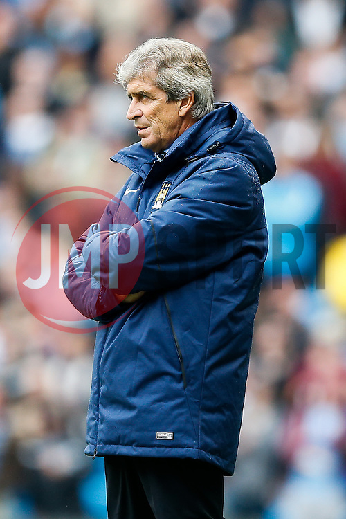 Manager Manuel Pellegrini of Manchester City looks on frustrated as his side struggle to score trailing 0-1 - Photo mandatory by-line: Rogan Thomson/JMP - 07966 386802 - 30/08/2014 - SPORT - FOOTBALL - Manchester, England - Etihad Stadium - Manchester City v Stoke City - Barclays Premier League.
