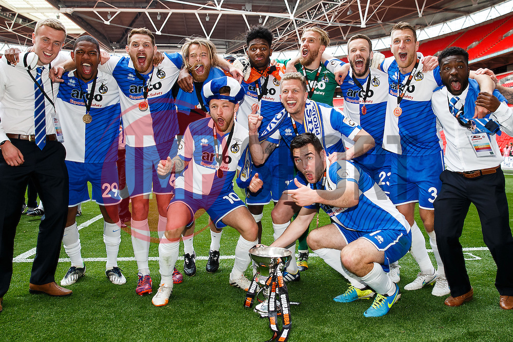 Bristol Rovers players celebrate with the trophy after they win the match on penalties  to secure promotion to the Football League 2 - Photo mandatory by-line: Rogan Thomson/JMP - 07966 386802 - 17/05/2015 - SPORT - FOOTBALL - London, England - Wembley Stadium - Bristol Rovers v Frimsby Town - Vanarama Conference Premier Play-off Final.