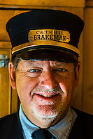 Brakeman aboard the Cumbres & Toltec Scenic Railroad train on the 64 mile run between Antonito, Colorado and Chama, New Mexico.The railroad is the highest and longest narrow gauge steam railroad in the United States with a track length of 64 miles. The train traverses the border between Colorado and New Mexico, crossing back and forth between the two states 11 times. The narrow gauge track is 3 feet wide. It runs over 10,015 ft (3,053 m) Cumbres Pass.