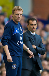 LIVERPOOL, ENGLAND - Sunday, August 30, 2009: Everton's manager David Moyes and Wigan Athletic's manager Roberto Martinez during the Premiership match at Goodison Park. (Photo by David Rawcliffe/Propaganda)