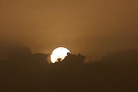 Sunrise at Roseau Dominica. Image taken with a Nikon D3x and 70-300 mm VR lens (ISO 180, 300 mm, f/16, 1/1000 sec).