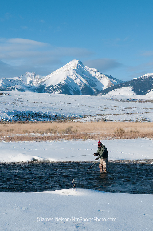 An angler fly fishes from trout on Birch Creek, Idaho, with the Lemhi Range as a backdrop.