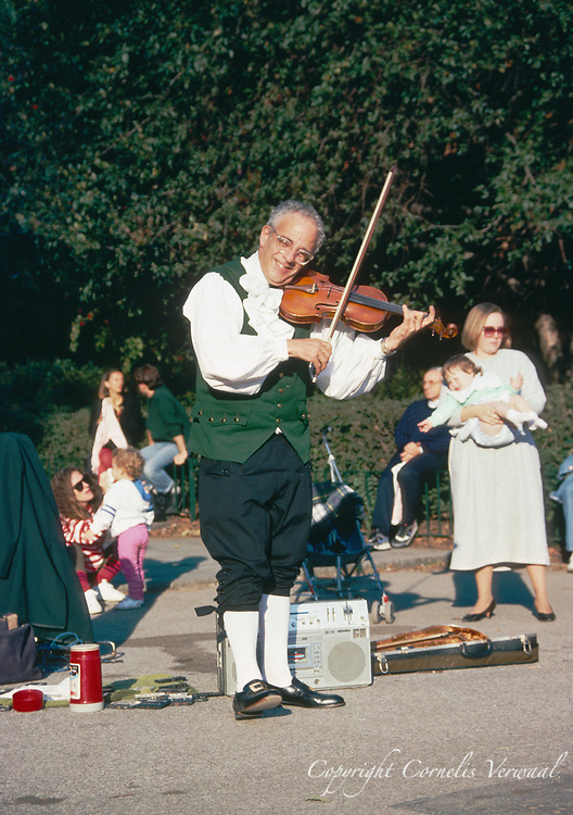 Violin player at the Sailboat Pond in Central Park, 1989.