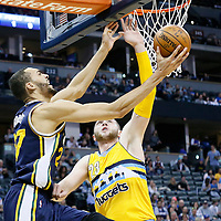 10 April 2016: Utah Jazz center Rudy Gobert (27) goes for the reverse layup past Denver Nuggets center Jusuf Nurkic (23) during the Utah Jazz 100-84 victory over the Denver Nuggets, at the Pepsi Center, Denver, Colorado, USA.
