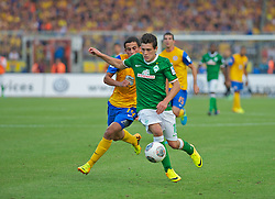 10.08.2013, Eintracht Stadion, Braunschweig, GER, 1. FBL, Eintracht Braunschweig vs SV Werder Bremen, 1. Runde, im Bild Zlatko Junuzovic (Bremen #16) am Ball beim Schuss zum Siegtreffer, verfolgt von Omar Elabdellaoui (Eintracht Braunschweig #14)  during the German Bundesliga 1st round match between Eintracht Braunschweig and SV Werder Bremen at the Eintracht stadium, Braunschweig, Germany on 2013/08/10. EXPA Pictures © 2013, PhotoCredit: EXPA/ Andreas Gumz <br /> <br /> *****ATTENTION - OUT OF GER*****