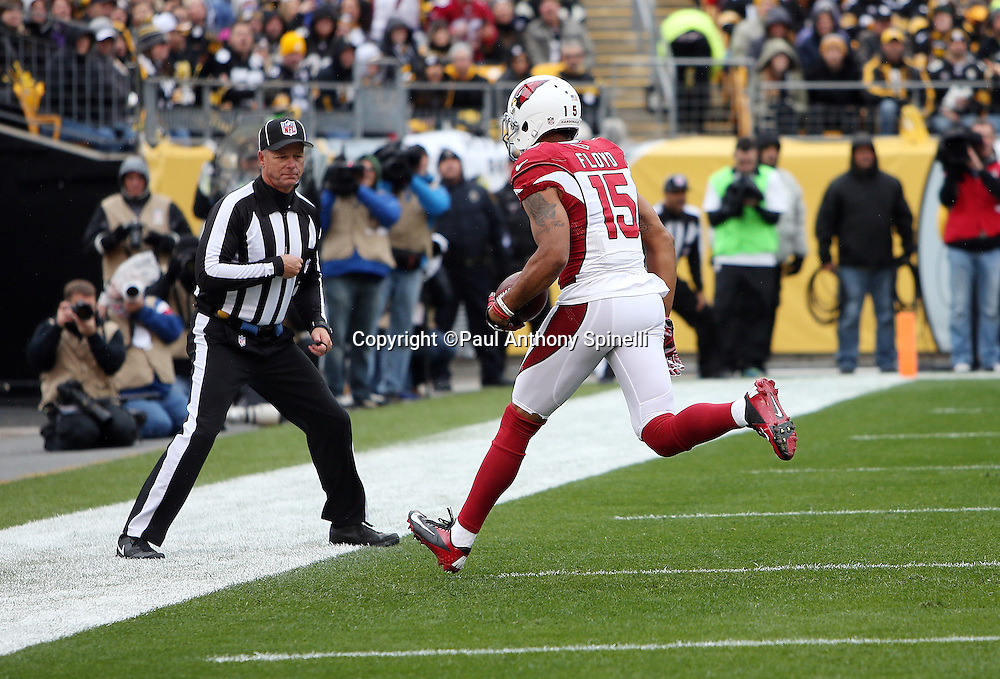 Arizona Cardinals wide receiver Michael Floyd (15) catches a 3 yard touchdown pass for a 7-0 first quarter lead during the 2015 NFL week 6 regular season football game against the Pittsburgh Steelers on Sunday, Oct. 18, 2015 in Pittsburgh. The Steelers won the game 25-13. (©Paul Anthony Spinelli)
