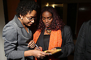 14 January 2011- Harlem, NY- l to r: Emeline Michel signs copies of her CD at The Celebrate Haiti Concert held at The Schomburg Center for Research in Black Culture on January 14, 2011 in Harlem, New York. Photo Credit: Terrence Jennings