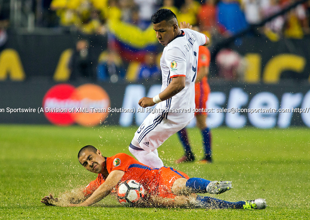 22 June 2016: Chile midfielder Francisco Silva (5) falls on the ball, covered by Colombia forward Rodger Martinez (9), during the Copa America Centenario Semifinal match between Colombia and Chile, at Soldier Field in Chicago, IL. Chile won 2-0 to advance to the finals to face Argentina. (Photo by Tony Ding/Icon Sportswire)