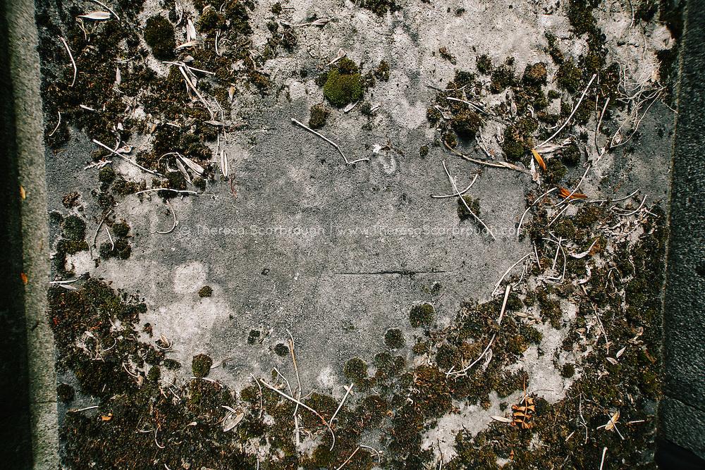 Detail of vintage headstone in cemetery