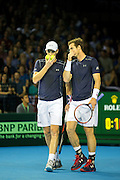 Andy Murray of Great Britain and Jamie Murray of Great Britain confer between a point during the 2016 Davis Cup Semi Final between Great Britain and Argentina at the Emirates Arena, Glasgow, United Kingdom on 17 September 2016. Photo by Craig Doyle.