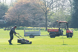 © Licensed to London News Pictures. 29/03/2019.<br /> Greenwich, UK. Groundsman cutting the cricket field grass, Bright and warm sunny spring weather today in Greenwich Park, Greenwich, London.  Photo credit: Grant Falvey/LNP
