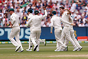 Pat Cummins celebrates the wicket of Joe Root during day three of the Australia v England fourth test at the Melbourne Cricket Ground, Melbourne, Australia on 28 December 2017. Photo by Mark  Witte.