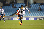 Millwall midfielder Fred Onyedinma (10) dribbling during the EFL Sky Bet League 1 match between Millwall and Shrewsbury Town at The Den, London, England on 10 December 2016. Photo by Matthew Redman.