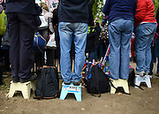 © Licensed to London News Pictures. 05/06/2012. London, UK. People stand on stools to watch the Jubilee Procession on the Mall today 5th June 2012.  The Royal Jubilee celebrations. Great Britain is celebrating the 60th  anniversary of the countries Monarch HRH Queen Elizabeth II accession to the throne this weekend Photo credit : Stephen Simpson/LNP