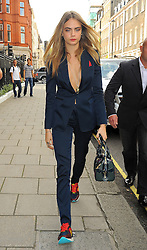 Model Cara Delevingne arriving at Claridges hotel after attending the Burberry catwalk show during London Fashion Week SS15 in London, UK. 15/09/2014<br />BYLINE MUST READ : GOTCHAIMAGES.COM<br /><br />Copyright by © Gotcha Images Ltd. All rights reserved.<br />Usage of this image is conditional upon the acceptance <br />of Gotcha Images Ltd, terms and conditions available at<br />www.gotchaimages.com