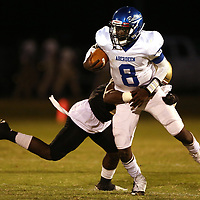 Aberdeen quarterback Fred Fields is wrapped up by Amory's Michael Williams during Friday night's game at Amory.
