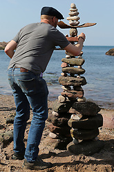 European Stone Stacking 2019 21 April 2019; Laurence Winram puts the finishing touches to his sculpture during the European Stone Stacking 2019 at Eye Cave Beach, Dunbar.<br /> <br /> (c) Chris McCluskie | Edinburgh Elite media