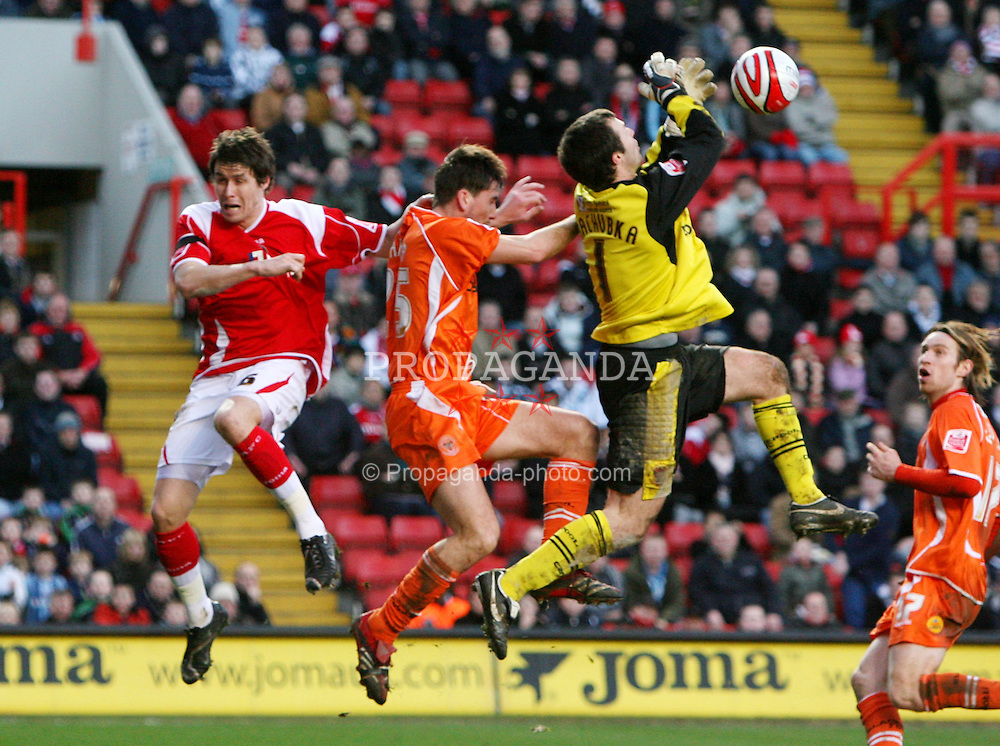 London, England - Saturday, January 12th, 2008:  Charlton Athletic's Paddy McCarthy in action against Blackpool's goalkeeper Paul Rachubka and Shaun Barker during the League Championship match at The Valley. (Pic by Chris Ratcliffe/Propaganda)