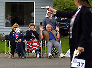 Gunslinger and professional pistol shooter Robin Bloom (aka Rocky Meadows) walks the parade route keeping the peace at the 68th Annual Linn County Lamb and Wool Fair. The Scio, Oregon, event features not only a themed parade but many lamb-related events and the residents work to keep the traditions alive.