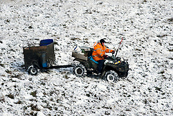 © Licensed to London News Pictures. 16/04/2016. Ribblehead UK. Picture shows a farmer working in the snow this morning after last night's snow fall in the Yorkshire Dales. Photo credit: Andrew McCaren/LNP